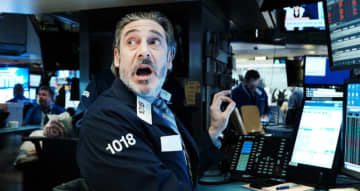 """The S&P; index of the 500 leading stocks fell so quickly it triggered """"circuit breakers"""" designed to ease panic selling. (Getty Images/AFP)"""