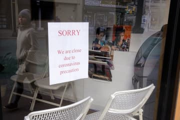 A hair salon is closed due to the virus in Jersey City. (Aristide Economopoulos | NJ Adva                    /)