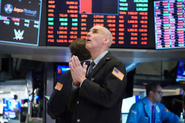 Wall Street stocks resumed their downward slide on Wednesday as the economic toll mounts from the near-shutdown of industrial and services sectors.