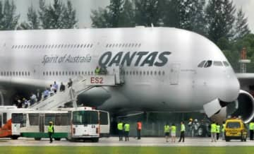 Qantas said its international flights would be suspended for at least two months.