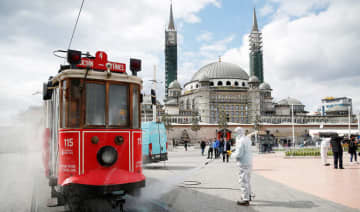 A municipality worker sprays disinfectant over a tram to prevent the spread of coronavirus in central Istanbul.