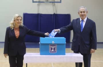Prime Minister Benjamin Netanyahu and his wife Sara vote at a Jerusalem polling station on March 2 (photo credit: MARC ISRAEL SELLEM)