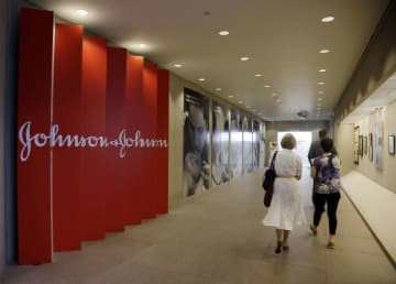 People walk along a corridor at the headquarters of Johnson & Johnson in New Brunswick, New Jersey.  (Mel Evans/)