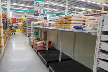 Shelves at a Tesco Lotus store are left empty as consumers stock up on basic consumer goods and rice amid fears over the spread of the coronavirus early this month. Pitsinee Jitpleecheep