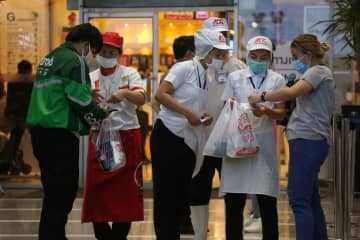 Restaurants at The Mall Bang Kapi see a rise in home delivery orders after their dining zones were ordered closed for 22 days as part of the government's efforts to contain the spread of the new coronavirus outbreak. Varuth Hirunyatheb