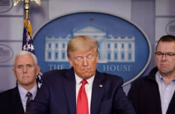 US President Donald Trump holds a news conference in Washington DC (photo credit: REUTERS/YURI GRIPAS)