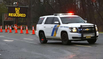 A New Jersey State Trooper guards the entrance of coronavirus drive thru testing center at PNC Bank Arts Center. March 23, 2020(Noah K. Murray   For NJ Advance Media/)