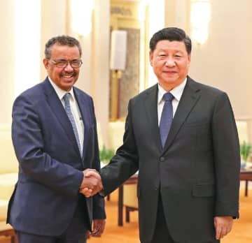 President Xi Jinping shakes hands with Tedros Adhanom Ghebreyesus, directorgeneral of the World Health Organization, at the Great Hall of the People in Beijing on Jan 28, 2020. [Photo by Feng Yongbin/China Daily]