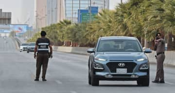 Policemen manning a checkpoint in Riyadh on the day of an emergency G20 videoconference to discuss a response to the coronavirus crisis.