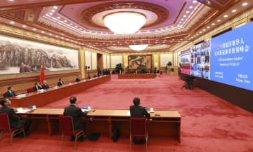 President Xi Jinping attends the G20 Extraordinary Leaders' Summit on COVID-19 on Thursday. The president participated in the summit, which took the form of a video conference, at the Great Hall of the People in Beijing. [Photo/Xinhua]