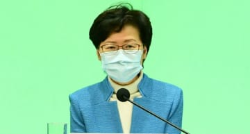Carrie Lam refuses to say whether Hong Kong will bar permanent residents from journalism, as Taiwan opens doors