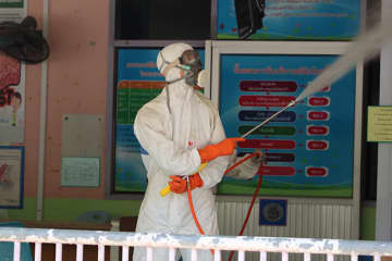 Officials spray disinfectant at Bannang Sata Hospital in Bannang Sata district of Yala after one doctor and two nurese were infected with the coronavirus. (Photo by Abdullah Benjakat)