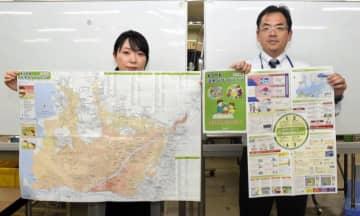 石手川と重信川の洪水浸水想定区域などを示した「まつやま洪水ハザードマップ」=27日午後、松山市役所