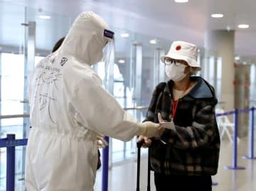 上海浦東空港、日本からの到着便に見る懇切で秩序ある検疫