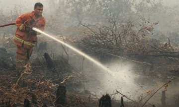 Cheneh forest reserve in T'ganu on fire