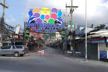 A barricade blocks entry to Soi Bangla in Phuket's Patong area, where all bars have been ordered closed to stem the spread of Covid-19. (Photo by Achadtaya Chuenniran)