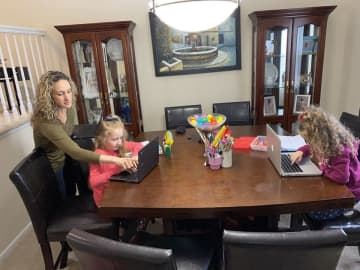 Nikki Silva, a Carteret elementary school teacher, works with her two daughters at home while also teaching her class remotely. ((Courtesy of Nikki Silva/)