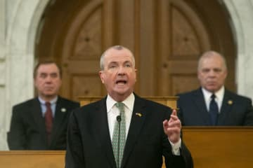 Gov. Phil Murphy (center) speaks at the Statehouse in Trenton earlier this year. To his left is state Assembly Speaker Craig Coughlin, and to his right is state Senate President Stephen Sweeney. (Aristide Economopoulos/)