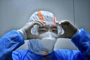 新型コロナ医療廃棄物の管理を重視、医療従事者らが清掃・消毒を担当 重慶市