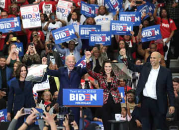 DETROIT, MICHIGAN - MARCH 09: Sen. Kamala Harris (L) (D-CA), Sen. Cory Booker (R)(D-NJ), and Michigan Governor Gretchen Whitmer join Democratic presidential candidate former Vice President Joe Biden on stage at a campaign rally at Renaissance...
