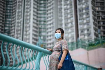 Jamie Chui has been a virtual prisoner in her Hong Kong home for most of her pregnancy, trapped intially by violent pro-democracy protests and tear gas, and then by the coronavirus — she now faces giving birth alone.