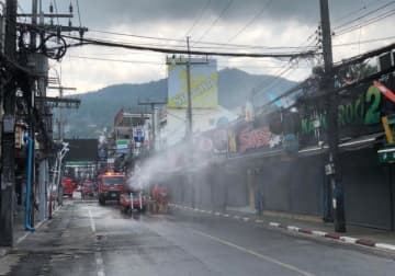 Soi Bangla in Phuket's Patong area is disinfected to stem the spread of Covid-19 on March 30. (Photo: Achadthaya Chuenniran)