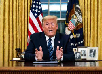 WASHINGTON, DC - MARCH 11: US President Donald Trump addresses the nation from the Oval Office about the widening Coronavirus crisis on March 11, 2020 in Washington, DC. President Trump said the US will suspend all travel from Europe - except...