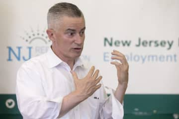 Former Gov. Jim McGreevey, the chair of the  New Jersey Reentry Program talks to participants at their Newark office. (Aristide Economopoulos   NJ Advance Media)    (Aristide Economopoulos   NJ Adva/)