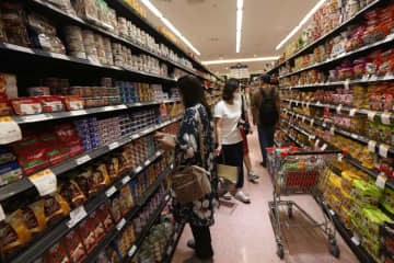 Consumers throng a supermarket for consumer goods.Varuth Hirunyatheb