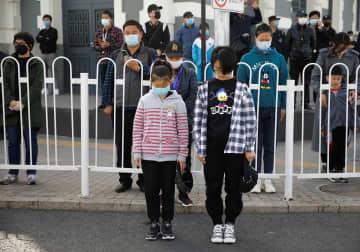 新型ウイルス肺炎が世界で流行 中国で一斉黙祷(写真:ロイター/アフロ)