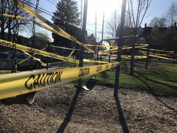 Caution tape surrounds a playground. (Sarah Cassi/)