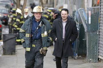While near the fire, Paterson Fire Chief Brian McDermott listens to Paterson Mayor Paterson Mayor Andre Sayegh.    (Aristide Economopoulos | NJ Adva                    /)