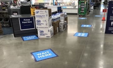 Floor markers at a Lowe's are just one of several measures the company is taking to promote social distancing.  (Joshua Gunter, cleveland.com/)