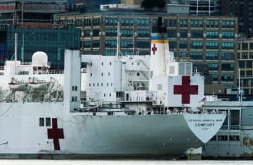 The USNS hospital ship Comfort is seen docked at Pier 90 on Manhattan's West Side as the outbreak of the coronavirus disease (COVID-19) continues in New York City (photo credit: EDUARDO MUNOZ / REUTERS)