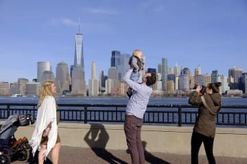 A couple have their son photographed while in Liberty State Park Saturday March 14, 2020 during the Coronavirus pandemic. (Aristide Economopoulos | NJ Advance Media for NJ.com)    (Aristide Economopoulos | NJ Adva                    /)