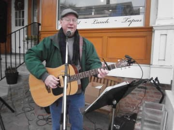 Thomas Johnston of Whitehouse Station sings Christmas songs at the Dickens Days celebration in Clinton. (Terry Wright/)