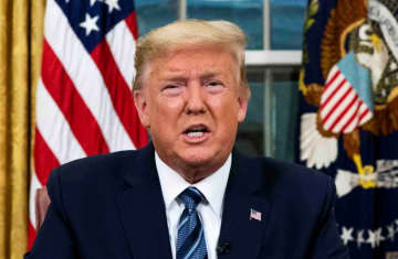 U.S. President Donald Trump speaks about the U.S response to the COVID-19 coronavirus pandemic during an address to the nation from the Oval Office of the White House in Washington, U.S., March 11, 2020 (photo credit: DOUG MILLS/POOL VIA REUTERS)