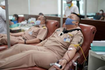 Navy sailors donate blood at the Thai Red Cross Society in Bangkok on Thursday, as the number of local cases of Covid-19 rose by 54 to 2,423. (Photo supplied)
