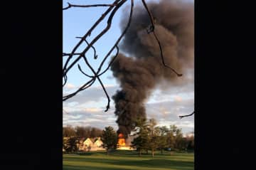 The fire was reported Wednesday evening on the grounds of Canoe Brook Country Club in Short Hills. (Daniel Cannon/)
