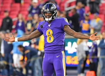LOS ANGELES, CA - NOVEMBER 25: Lamar Jackson #8 of the Baltimore Ravens warms up before the game against the Los Angeles Rams at Los Angeles Memorial Coliseum on November 25, 2019 in Los Angeles, California.