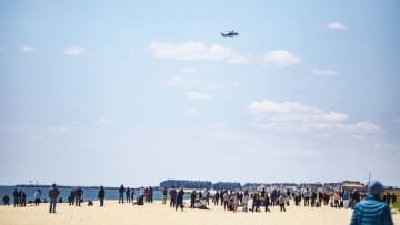 A crowd on the beach in Sea Girt watches a N.J. State Police helicopter land on Tuesday, May 12. People have taken to online shaming those who are not staying at home. (Andrew Mills | NJ Advance Media for NJ.com) (Andrew Mills | NJ Advance Media/)