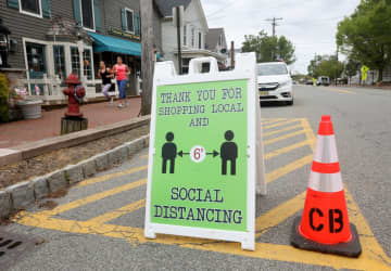 A sign of the times along Main Street in Chester on May, 18, 2020. Businesses can now re-open for curbside pickups. (Ed Murray | NJ Advance Media for/)