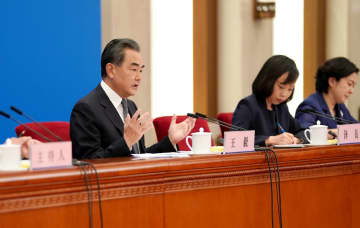 State Councilor and Foreign Minister Wang Yi answers a question at a news conference on the sidelines of the annual national legislative session in Beijing on May 24, 2020. [Photo/Xinhua]