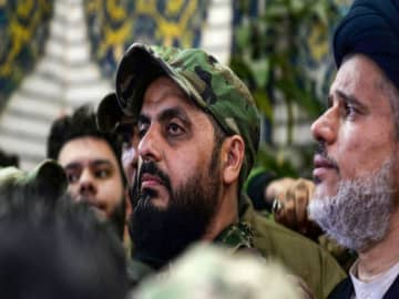 WATCH: Gunmen set fire to Iraqi paramilitary group's headquarters amid rising anti-Iran sentiment