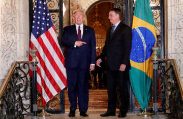 U.S. President Donald Trump hosts a photo-op with Brazilian President Jair Bolsonaro before attending a working dinner at the Mar-a-Lago resort in Palm Beach, Florida, U.S., March 7, 2020 (photo credit: REUTERS/TOM BRENNER)