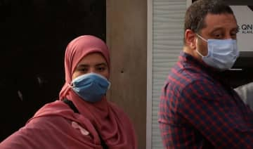 People are pictured wearing protective face masks, amid concerns over the coronavirus disease (COVID-19), in Cairo, Egypt.