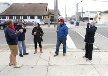 A group enjoy drinks on the sidewalk in front of Tacos and Tequila in North Wildwood on Sunday, May 24, 2020.(Tim Hawk | NJ Advance Media for NJ.com/)