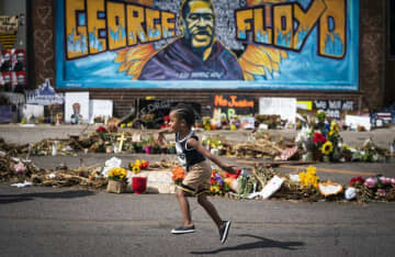 One month after George Floyd's death, Minneapolis struggles with interlocking crises