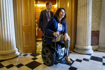 Sen. Tammy Duckworth fires back at Fox News' Tucker Carlson after he questions her patriotism