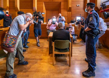 Austrian who killed ex-girlfriend and family members stands trial